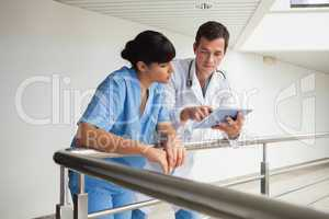 Doctor explaining some exercises to a nurse