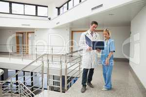 Nurse and doctor looking in folder