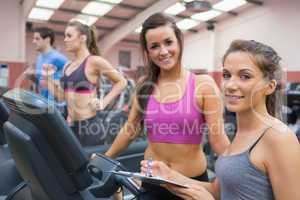 Happy women in the gym during assessment