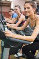 Four people enjoying time on exercise bikes