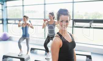 Happy woman at aerobics class