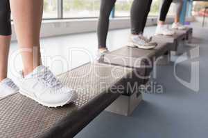 Womens feet stepping in aerobics class