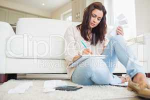 Young woman working out finances