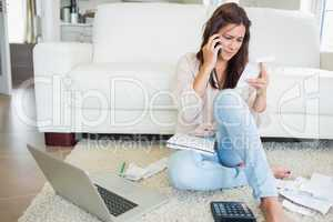 Woman calling and reading a bill