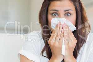 Brunette sneezing
