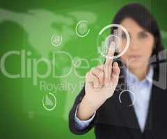 Businesswoman touching one button on green screen