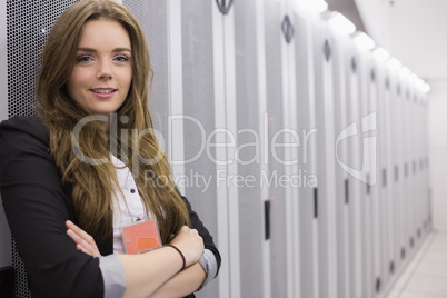 Happy girl standing in data storage facility