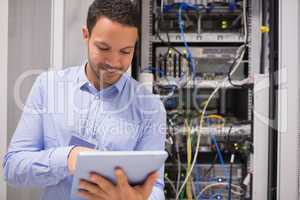 Data centre worker with tablet computer