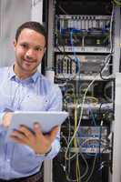Man with tablet pc in data centre