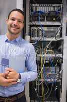 Man standing in front of servers
