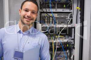 Man smiling in front of the servers