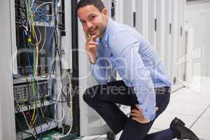Smiling man checking the servers