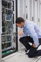 Technician looking at cables of the server