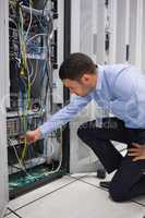 Man plugging a cable into server