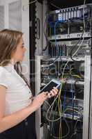 Woman with tablet pc looking at the servers