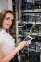 Woman checking servers with tablet pc
