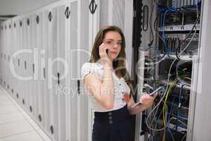 Brunette calling while checking servers with tablet pc