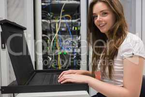 Smiling woman searching through servers