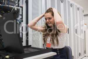 Stressed woman working on the server
