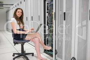 Smiling woman doing data storage