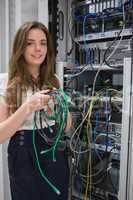 Woman holding server wires