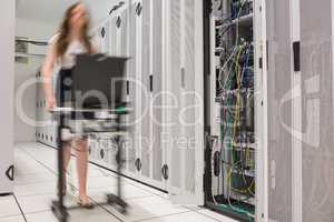 Woman pushing computer to open servers