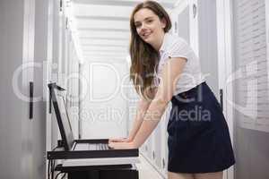 Female technician doing maintenance on servers