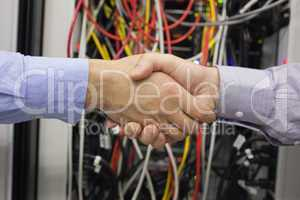 Hand shake in front of wires
