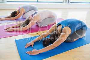 Women doing childs pose in yoga class