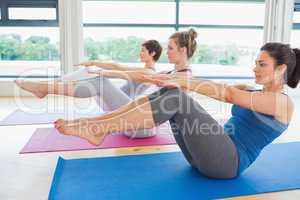 Women in boat pose in yoga class