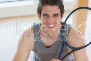 Happy man holding a tennis racket