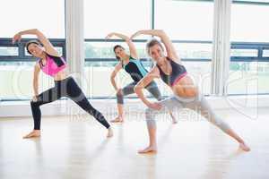 Women stretching in fitness studio