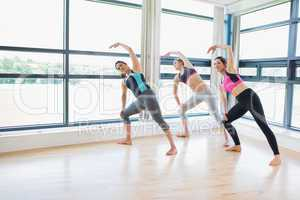 Women standing at the gym stretching