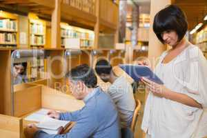 Woman holding tablet pc in the library