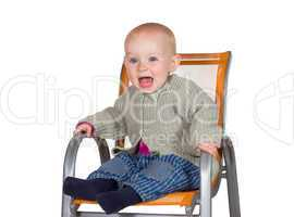 Distressed tearful baby in highchair