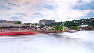 The Bundeskanzleramt (Kanzleramt) with dynamic Spree River Speed Boats in 1080p FullHD - famous landmark in Berlin, Germany