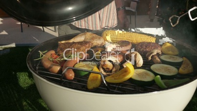closeup opening barbecue grill