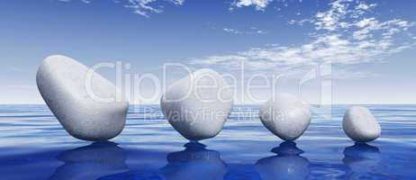 White stones on blue water
