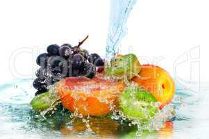 fruit in a spray of water