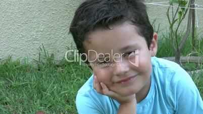 Little boy shows the sign of OK