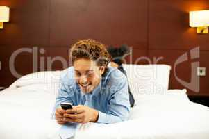 Excited young man waiting for message reply