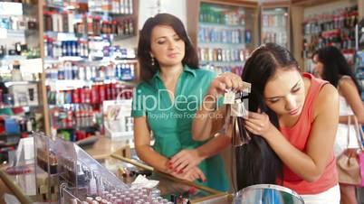 Girl Choosing Tone of Hair Dye in Beauty Department