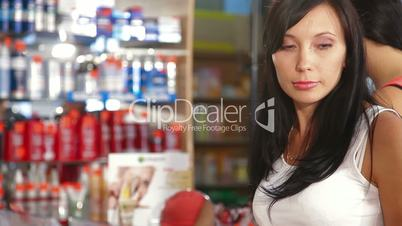 Female Customers Buying Beauty Care Products