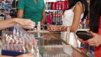 Woman Paying For Beauty Care Products