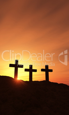 3 Kreuze am Berg bei Sonnenuntergang - vertikal