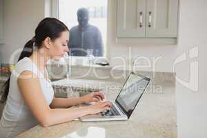 Burglar observing young woman