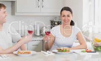 Two people enjoying their meal