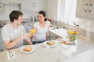 Two people eating and drinking