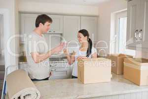 Two people celebrating their move