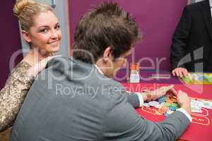 Woman smiling as man is taking winnings